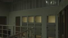 Pan of jail cell block Stock Footage