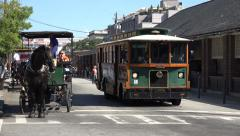 Tourist trolley bus passes city market, charleston, sc, usa Stock Footage