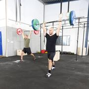 Clean and jerk workout at fitness gym center Kuvituskuvat