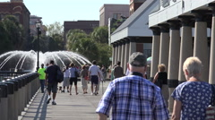 people walk along charleston waterfront park pier, sc, usa - stock footage