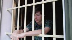 Juvenile prison,teenager incarcerated,behind bars,detention center,captive kid Stock Footage