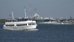 Spiritline cruises tour boat passes uss yorktown, charleston, sc, usa Stock Footage