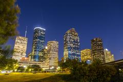 view on downtown houston by night - stock photo