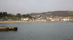 Lyme Regis beach, town and sea from the Cobb breakwater Stock Footage