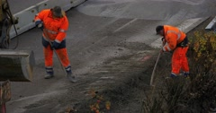 4k, two construction workers shoveling gravel on highway Stock Footage