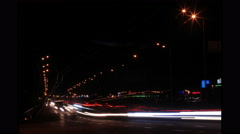 Movement of cars in  night city with fires of headlights. 4K ( 4096x2304). Time - stock footage