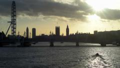 London skyline at sunset with a boat in the river Thames Arkistovideo
