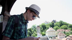 Tourist using a guide, travel, vacation, visit old medieval town, Transylvania Stock Footage