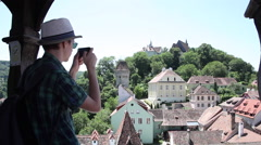 Young tourist, taking pictures, smart phone, beautiful medieval town, romantic Stock Footage