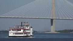 Stock Video Footage of carolina queen riverboat passes arthur ravenel jr bridge, charleston, sc, usa