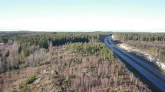 Drone view of Finland Highway traffic and forest Stock Footage