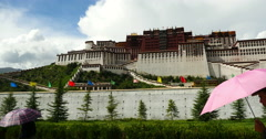 4k tibetan people pilgrimage Potala in Lhasa,Tibet.white puffy cloud mass fly. Stock Footage
