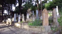 Tombs, tombstones, gravestones, sunlight, graveyard, old cemetery Stock Footage