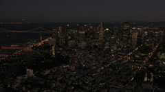 Aerial illuminated San Francisco Skyscrapers Bay Bridge USA Stock Footage