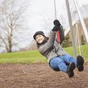 young woman enjoy in the playground - stock photo
