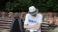 Teenage boy waiting, watch, impatient young man, date, park Stock Footage