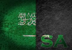 old rusty metal sign with a flag and country abbreviation Saudi Arabia - stock photo