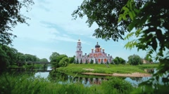 Russian Orthodox Brick Church with Bell Tower on an Island Stock Footage