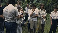 Peru 1979: visitors in an amazon forest village - stock footage