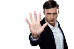 Stock Photo of buisnessman making stop gesture. focus on a hand
