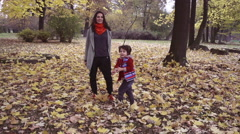 Happy mother walking with son, steadycam shot, slow motion shot at 240fps Stock Footage