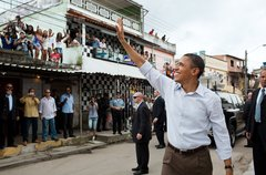 President Barack Obama waves to people gathered on the street outside the Cid Free Stock Photos