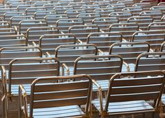empty metal seats places in public space - stock photo