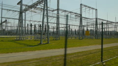 Car driven dolly view on Electricity Substation Stock Footage