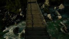Crossing a suspension bridge Stock Footage