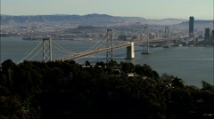 Aerials USA San Francisco Oakland Bay Bridge city - stock footage