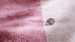 Earring on bedspread Stock Footage