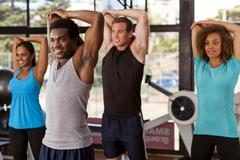 multi-ethnic group in a gym - stock photo