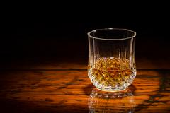 Whisky and wood in spotlight Stock Photos