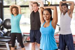 Stock Photo of multi-ethnic group stretching in a gym