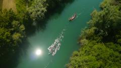Aerial HD: Canoes with Sun Reflection on the River Stock Footage