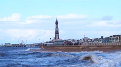 Blackpool tower and incoming tide - stock footage