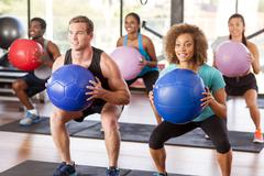 Stock Photo of gym class doing squats
