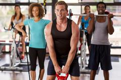 group exercising in a gym - stock photo