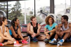group relaxing before a gym class - stock photo