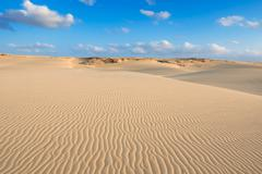 waves on sand dunes  in chaves beach praia de chaves in boavista cape verde - - stock photo