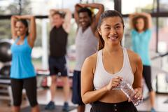 young asian woman in a gym - stock photo