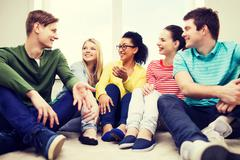 five smiling teenagers having fun at home - stock photo