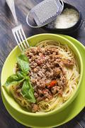 spaghetti with bolognese sauce and parmesan cheese. - stock photo