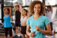 Stock Photo of young mixed-race woman in a gym