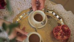 Young and beautiful couple having breakfast and drinking coffee Stock Footage
