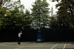 President Barack Obama shoots hoops on the White House Basketball Court durin Free Stock Photos