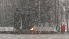 Snowfall in the city on the background of the monument 1 Stock Footage