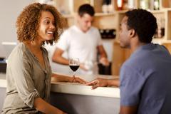 Couple talking in a bar Stock Photos