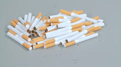 Cigarettes scattered on the table Stock Footage