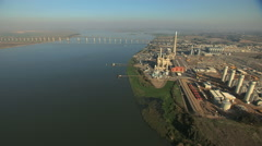 Aerial San Francisco Bay ocean Bridge Antioch factory Stock Footage